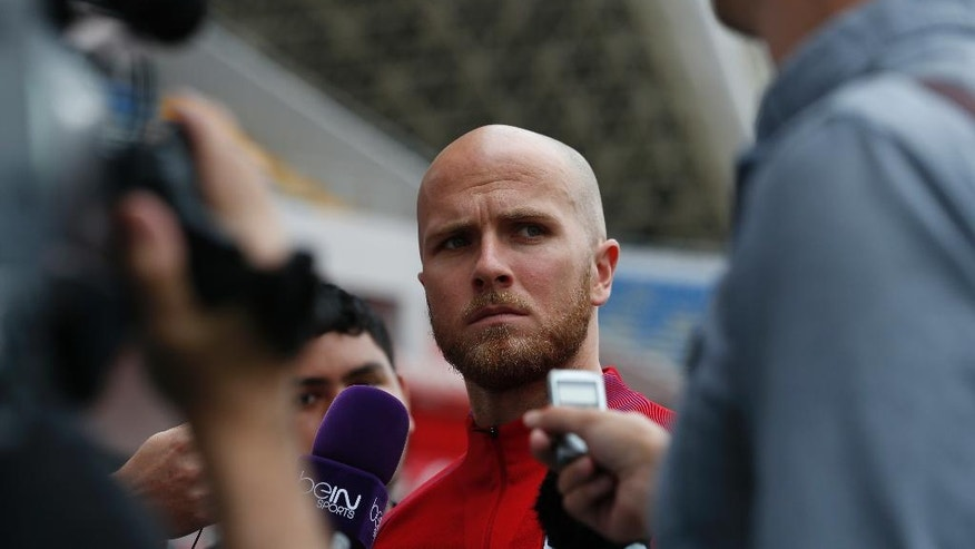 United States' Michael Bradley, center, listens to a question from the press before a training session at the National Stadium, in San Jose, Costa Rica, Monday, Nov. 14, 2016. United States will face Costa Rica for 2018 World Cup qualifying soccer match Tuesday. (AP Photo/Moises Castillo)