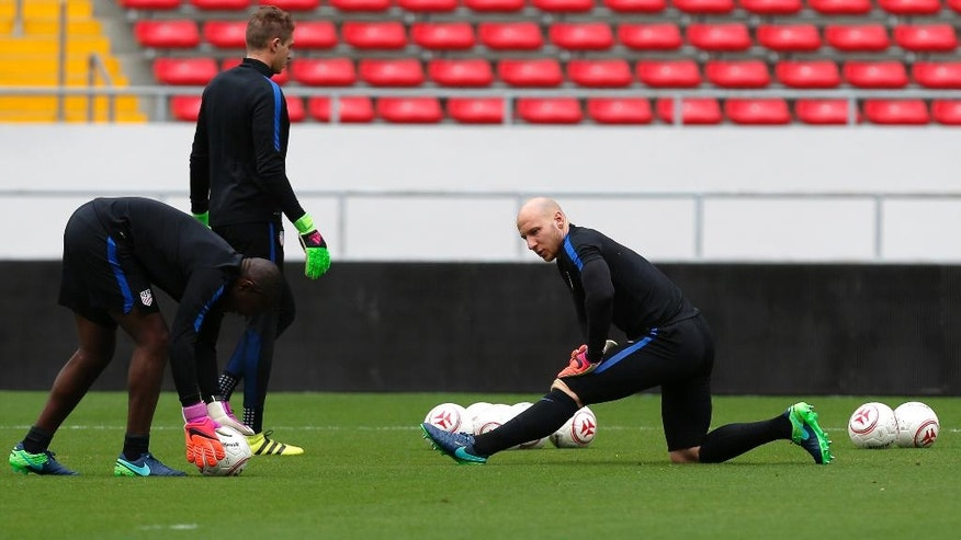 United States goalkeeper Brad Guzan, right, stretches during a training session at the National Stadium, in San Jose, Costa Rica, Monday, Nov. 14, 2016. United States will face Costa Rica for 2018 World Cup qualifying soccer match Tuesday. (AP Photo/Moises Castillo)