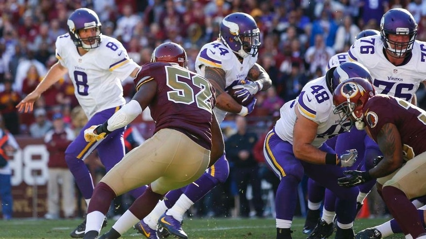 Minnesota Vikings running back Matt Asiata (44) carries the ball past Washington Redskins linebacker Terence Garvin (52) for a touchdown during the first half of an NFL football game in Landover, Md., Sunday, Nov. 13, 2016. (AP Photo/Alex Brandon)