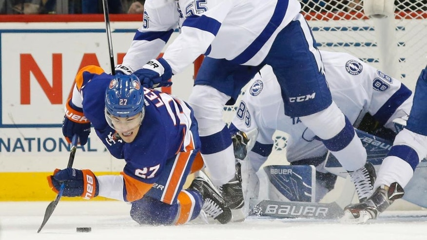 Tampa Bay Lightning defenseman Braydon Coburn (55) shoves New York Islanders' left wing Anders Lee (27) in front of Lightning goalie Andrei Vasilevskiy (88) of Russia during the first period of an NHL hockey game, Monday, Nov. 14, 2016, in New York. (AP Photo/Kathy Willens)