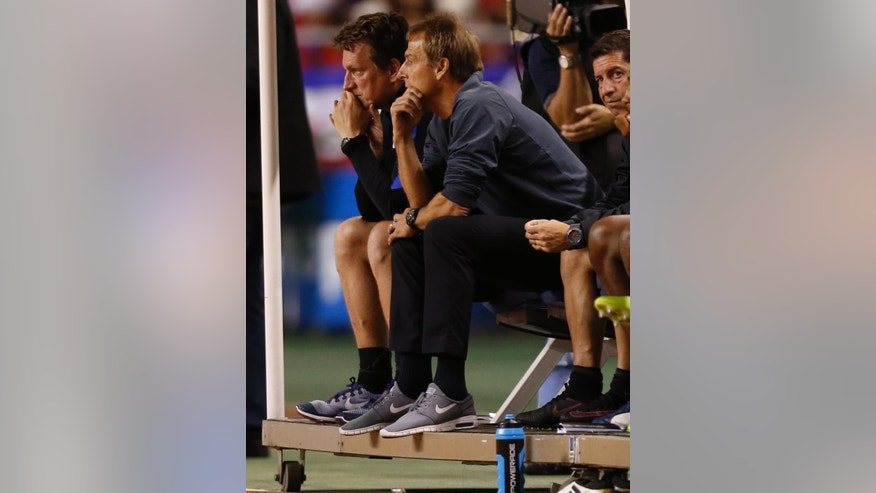 United States coach Jurgen Klinsmann sits on the bench during a 2018 World Cup qualifying soccer match against Costa Rica in San Jose, Costa Rica, Tuesday, Nov. 15, 2016. (AP Photo/Moises Castillo)
