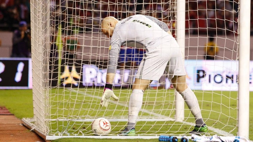 United States goalkeeper Brad Guzan picks up the ball the ball inside the goal after Costa Rica's 4th goal, scored by Joel Campbell during a 2018 World Cup qualifying soccer match in San Jose, Costa Rica, Tuesday, Nov. 15, 2016. (AP Photo/Moises Castillo)