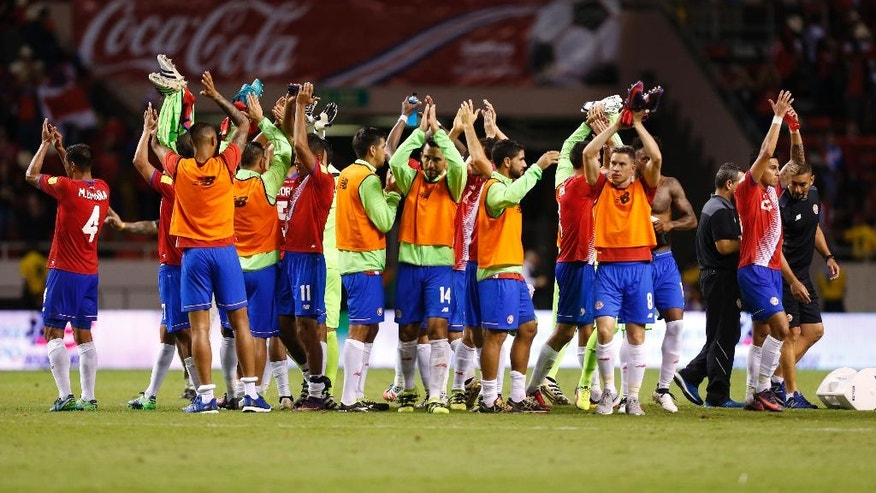 Costa Rica's players celebrate at the end of a 2018 World Cup qualifying soccer match against United States in San Jose, Costa Rica, Tuesday, Nov. 15, 2016. Costa Rica won the match 4-0. (AP Photo/Moises Castillo)