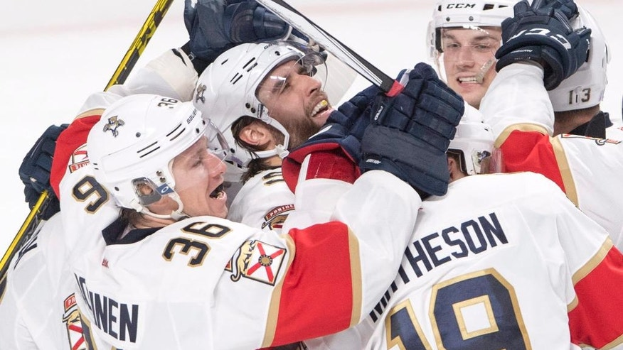 Florida Panthers defenceman Aaron Ekblad, center, celebrates with teammates after scoring the winning goal during overtime in an NHL hockey game, Tuesday, Nov. 15, 2016 in Montreal.  (Ryan Remiorz/The Canadian Press via AP)