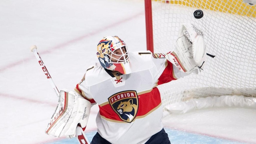 Florida Panthers goalie Roberto Luongo (1) makes a save against the Montreal Canadiens during the second period of an NHL hockey game, Tuesday, Nov. 15, 2016 in Montreal.  (Ryan Remiorz/The Canadian Press via AP)