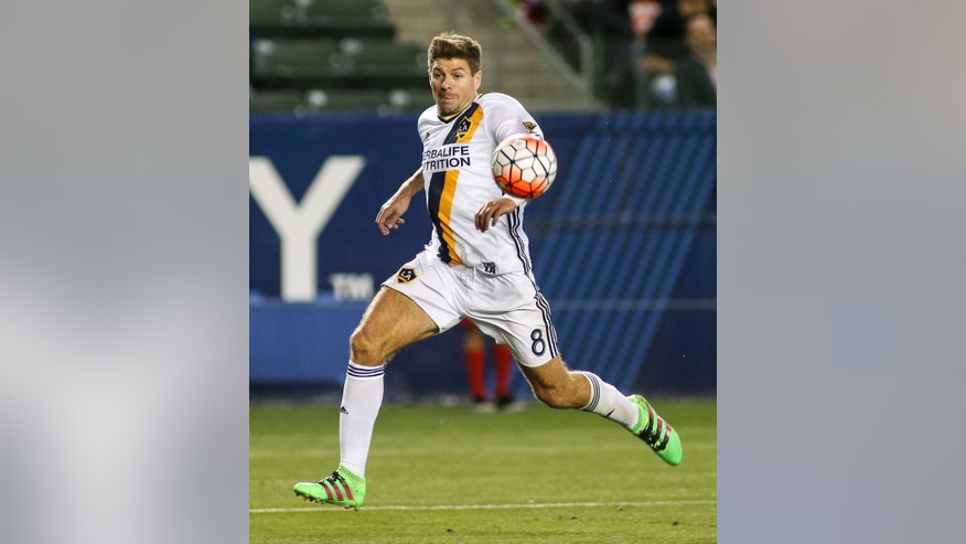FILE - In this Feb. 24, 2016, file photo, Los Angeles Galaxy midfielder Steven Gerrard moves the ball during the second half of a CONCACAF Champions League quarterfinal against Santos Laguna in Carson, Calif. Gerrard is leaving the LA Galaxy after two seasons, and the former England midfielder is still considering what to do next.(AP Photo/Ringo H.W. Chiu, File)