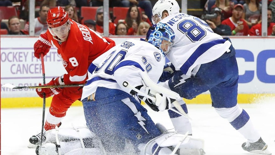 Tampa Bay Lightning goalie Ben Bishop (30) stops a Detroit Red Wings left wing Justin Abdelkader (8) shot in the second period of an NHL hockey game Tuesday, Nov. 15, 2016 in Detroit. (AP Photo/Paul Sancya)
