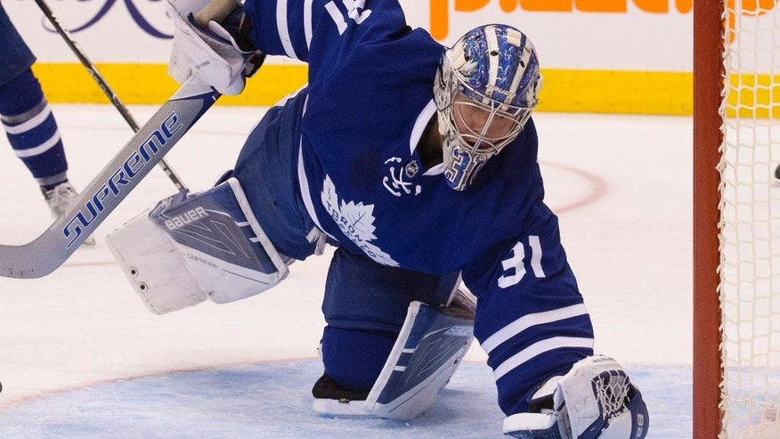 Toronto Maple Leafs goalie Frederik Andersen reaches for a loose puck during the first period against the Nashville Predators in an NHL hockey game Tuesday, Nov. 15, 2016, in Toronto. (Peter Power/The Canadian Press via AP)