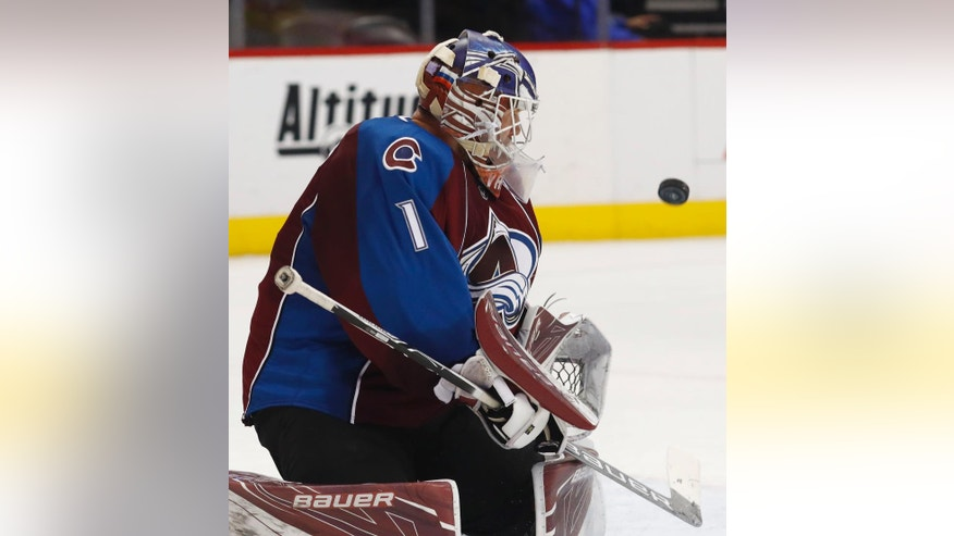 Colorado Avalanche goalie Semyon Varlamov, of Russia, deflects a shot against the Los Angeles Kings in the second period of an NHL hockey game Tuesday, Nov. 15, 2016, in Denver. (AP Photo/David Zalubowski)