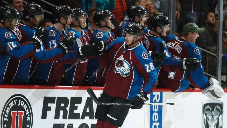 Colorado Avalanche defenseman Patrick Wiercioch, front, is congratulated as he passes the team box after scoring a goal against the Los Angeles Kings in the second period of an NHL hockey game Tuesday, Nov. 15, 2016, in Denver. (AP Photo/David Zalubowski)