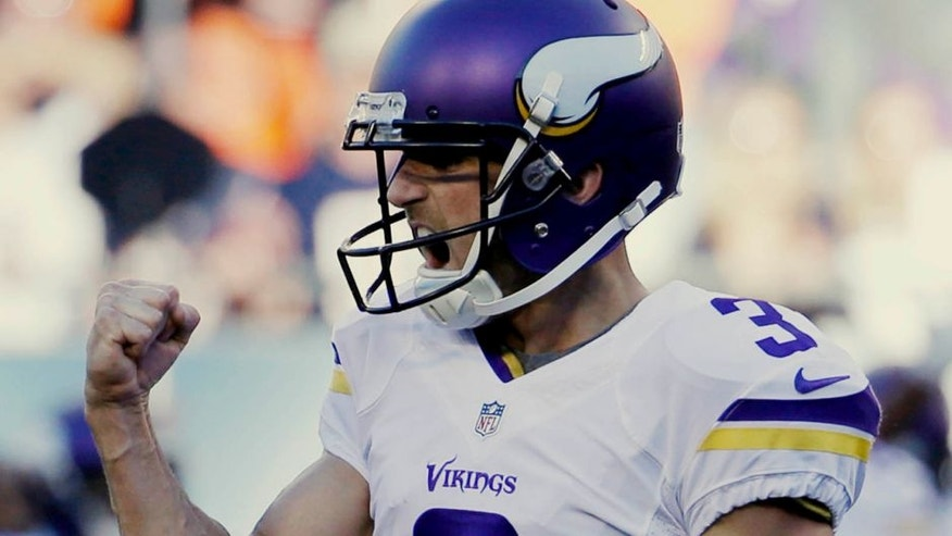 Minnesota Vikings kicker Blair Walsh pumps his fist after kicking the game-winning field goal against the Chicago Bears during the second half of an NFL football game Sunday, Nov. 1, 2015, in Chicago. The Vikings won 23-20.