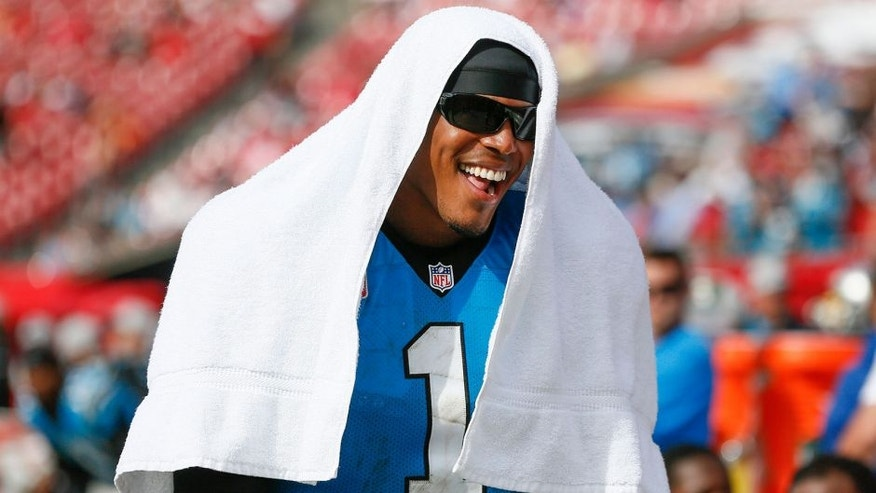 Oct 4, 2015; Tampa, FL, USA; Carolina Panthers quarterback Cam Newton (1) has a laugh with teammates on the side line during the fourth quarter of an NFL football game against the Tampa Bay Buccaneers at Raymond James Stadium. Carolina won 37-23. Mandatory Credit: Reinhold Matay-USA TODAY Sports