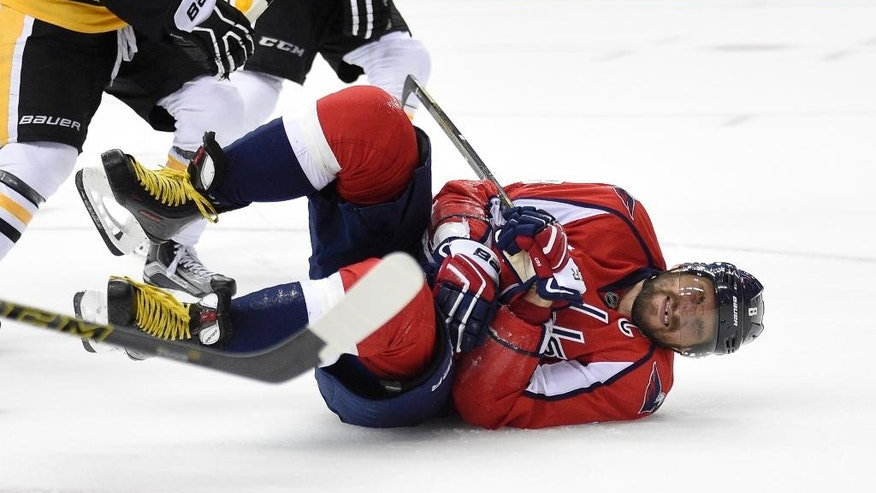 Washington Capitals left wing Alex Ovechkin (8), of Russia, reacts after he was injured during the second period of an NHL hockey game against the Pittsburgh Penguins, Wednesday, Nov. 16, 2016, in Washington. Ovechkin left the game temporarily and returned. (AP Photo/Nick Wass)
