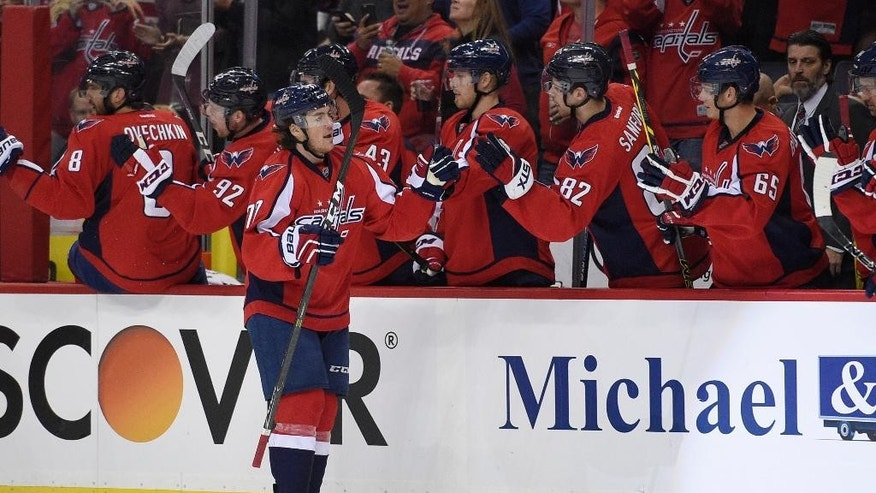 Washington Capitals right wing T.J. Oshie (77) celebrates his goal during the first period of an NHL hockey game against the Pittsburgh Penguins, Wednesday, Nov. 16, 2016, in Washington. (AP Photo/Nick Wass)