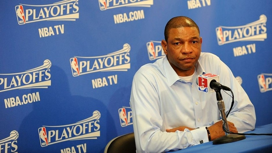 OAKLAND, CA - APRIL 27: Head Coach Doc Rivers of the Los Angeles Clippers talks to the media prior to the game against the Golden State Warriors in Game Four of the Western Conference Quarterfinals at Oracle Arena on April 27, 2014 in Oakland, California. NOTE TO USER: User expressly acknowledges and agrees that, by downloading and/or using this Photograph, user is consenting to the terms and conditions of the Getty Images License Agreement. Mandatory Copyright Notice: Copyright 2014 NBAE (Photo by Noah Graham/NBAE via Getty Images)