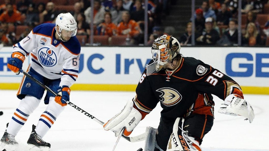 Anaheim Ducks goalie John Gibson, right, blocks a shot by Edmonton Oilers left wing Benoit Pouliot during the first period of an NHL hockey game in Anaheim, Calif., Tuesday, Nov. 15, 2016. (AP Photo/Alex Gallardo)