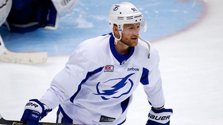 FILE - In a Sunday May 15, 2016 file photo, Tampa Bay Lightning's Steven Stamkos skates during hockey practice at the Consol Energy Center in Pittsburgh. With the NHL draft weekend out of the way, let the Stamkos free-agency watch begin. The Buffalo Sabres are interested, as are Toronto, Detroit and Vancouver, in the Tampa Bay Lightning captain who is eligible to become a free agent on July 1. (AP Photo/Gene J. Puskar, File)