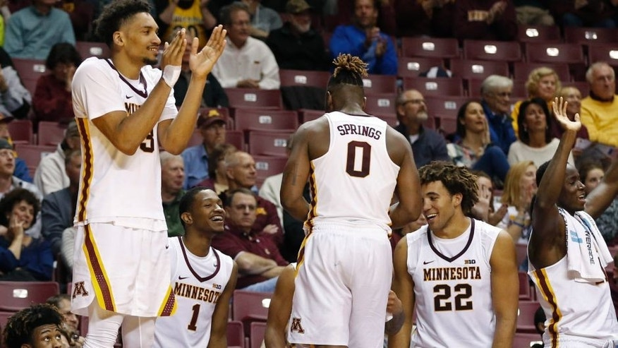 Minnesota's Jordan Murphy, left, applauded bench players as teammates celebrated the final moments of their team's 80-56 win over Mount St. Mary's in an NCAA college basketball game Wednesday, Nov. 16, 2016, in Minneapolis. Murphy led Minnesota with 18 points. (AP Photo/Jim Mone)