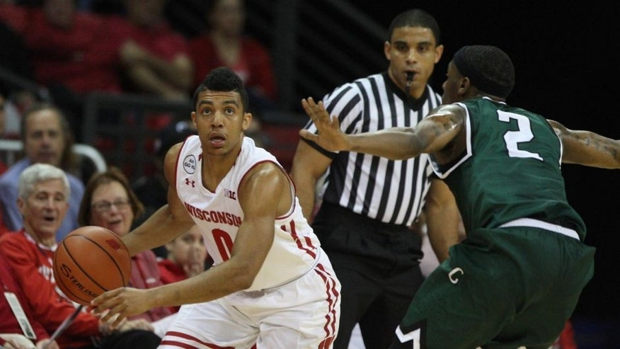 Nov 17, 2016; Madison, WI, USA; Wisconsin Badgers guard D'Mitrik Trice (0) controls the ball as Chicago State Cougars guard Clemmlye Owens V (2) defends at the Kohl Center. Mandatory Credit: Mary Langenfeld-USA TODAY Sports