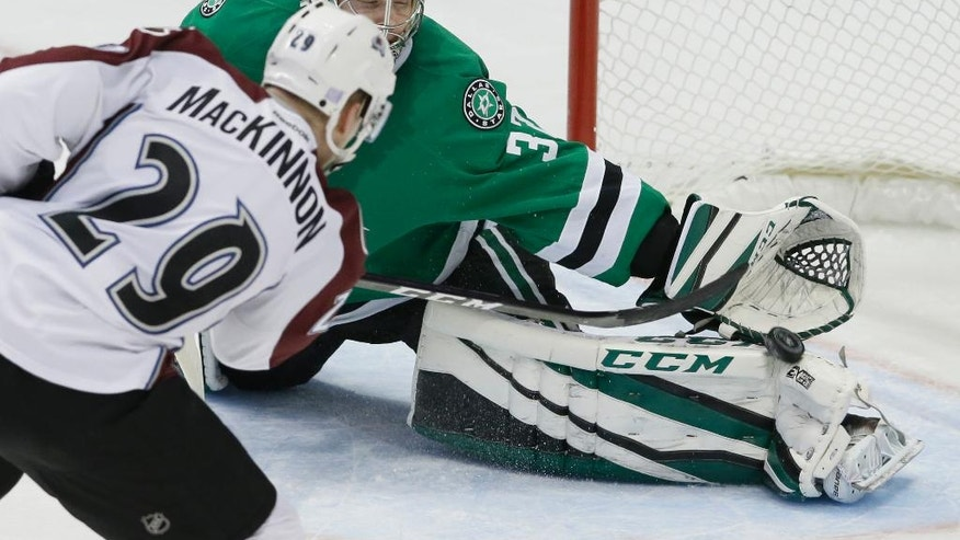 Dallas Stars goalie Kari Lehtonen (32) blocks a shot by Colorado Avalanche center Nathan MacKinnon (29) during the third period of an NHL hockey game in Dallas, Thursday, Nov. 17, 2016. (AP Photo/LM Otero)