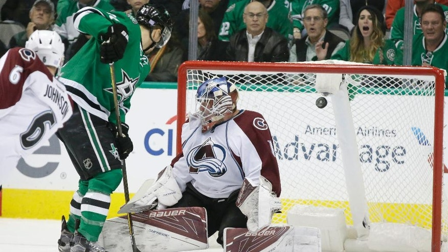 Colorado Avalanche goalie Semyon Varlamov (1) cannot stop a shot by Dallas Stars' Brett Ritchie (not shown), allowing the goal, as Dallas Stars left wing Antoine Roussel (21) and Avalanche defenseman Erik Johnson (6) look on during the first period of an NHL hockey game in Dallas, Thursday, Nov. 17, 2016. (AP Photo/LM Otero)