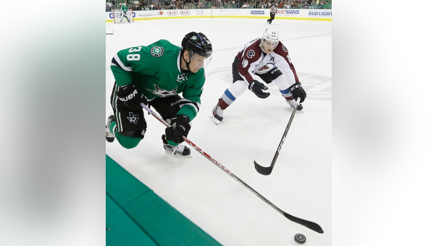Dallas Stars left wing Lauri Korpikoski (38) and Colorado Avalanche center Nathan MacKinnon (29) chase the puck during the first period of an NHL hockey game in Dallas, Thursday, Nov. 17, 2016. (AP Photo/LM Otero)
