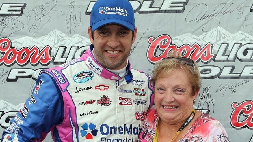 CHARLOTTE, NC - OCTOBER 12: Elliott Sadler, driver of the #2 OneMain Financial Chevrolet, poses with the Coors Light Pole Award and his mother Bell Sadler after qualifying for pole position for the NASCAR Nationwide Series Dollar General 300 at Charlotte Motor Speedway on October 12, 2012 in Charlotte, North Carolina. (Photo by Streeter Lecka/Getty Images)
