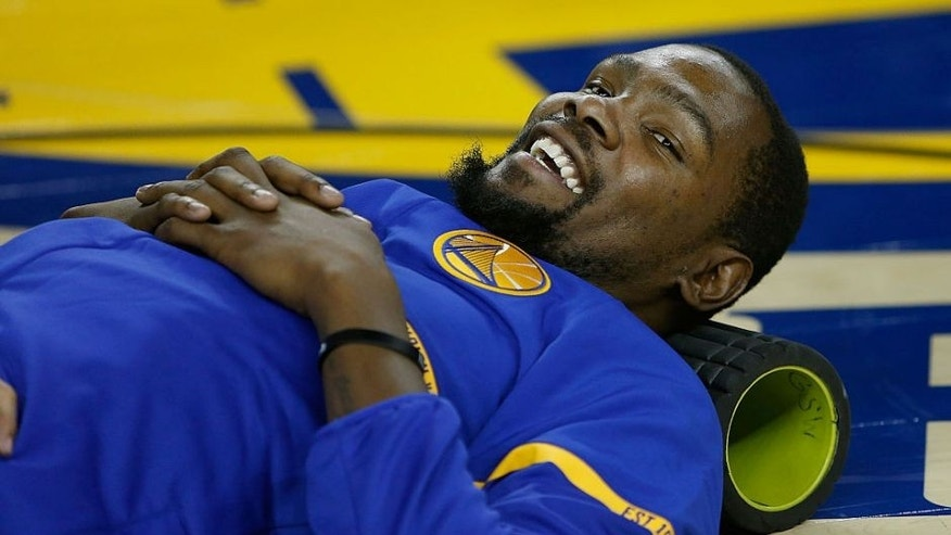 OAKLAND, CA - NOVEMBER 03: Kevin Durant #35 of the Golden State Warriors warms up before the game against the Oklahoma City Thunder at ORACLE Arena on November 3, 2016 in Oakland, California. NOTE TO USER: User expressly acknowledges and agrees that, by downloading and or using this photograph, user is consenting to the terms and conditions of Getty Images License Agreement. (Photo by Lachlan Cunningham/Getty Images)