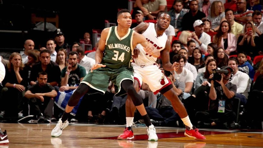 MIAMI, FL - NOVEMBER 17: Giannis Antetokounmpo #34 of the Milwaukee Bucks boxes out Dion Waiters #11 of the Miami Heat on November 17, 2016 at American Airlines Arena in Miami, Florida. NOTE TO USER: User expressly acknowledges and agrees that, by downloading and or using this Photograph, user is consenting to the terms and conditions of the Getty Images License Agreement. Mandatory Copyright Notice: Copyright 2016 NBAE (Photo by Issac Baldizon/NBAE via Getty Images)