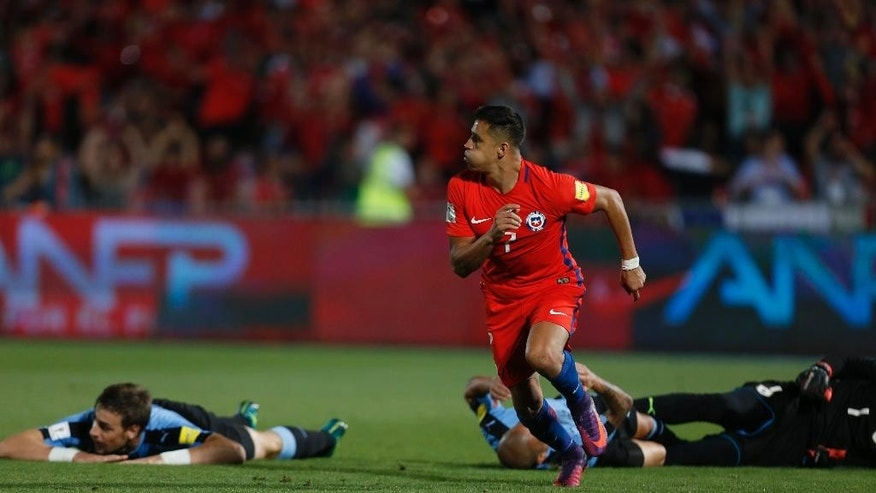 Chile's Alexis Sanchez celebrates after scoring against Uruguay's, during a 2018 World Cup qualifying soccer match in Santiago, Chile, Tuesday, Nov. 15, 2016. (AP Photo/Luis Hidalgo)