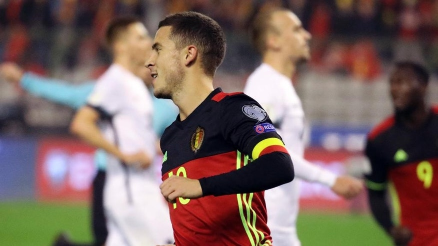 Belgium's Eden Hazard celebrates scoring gainst Estonia during the World Cup Group H qualifying soccer match between Belgium and Estonia,  at the King Baudouin Stadium in Brussels on Sunday, Nov. 13, 2016.  (AP Photo/Olivier Matthys)