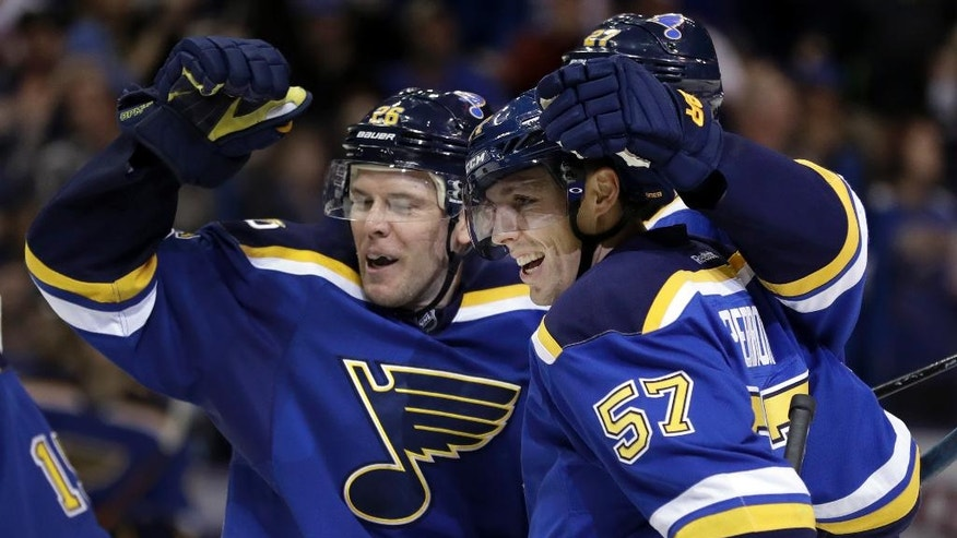 St. Louis Blues' David Perron (57) is congratulated by teammate Paul Stastny, left, after scoring during the second period of an NHL hockey game against the San Jose Sharks, Thursday, Nov. 17, 2016, in St. Louis. (AP Photo/Jeff Roberson)