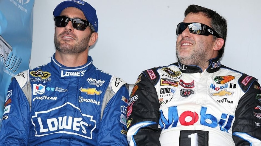 BROOKLYN, MI - AUGUST 16: (L-R) Jimmie Johnson, driver of the #48 Lowe's Chevrolet, and Tony Stewart, driver of the #14 Mobil 1/Bass Pro Shops Chevrolet, during driver introductions before the NASCAR Sprint Cup Series Pure Michigan 400 at Michigan International Speedway on August 16, 2015 in Brooklyn, Michigan. (Photo by Jerry Markland/Getty Images)