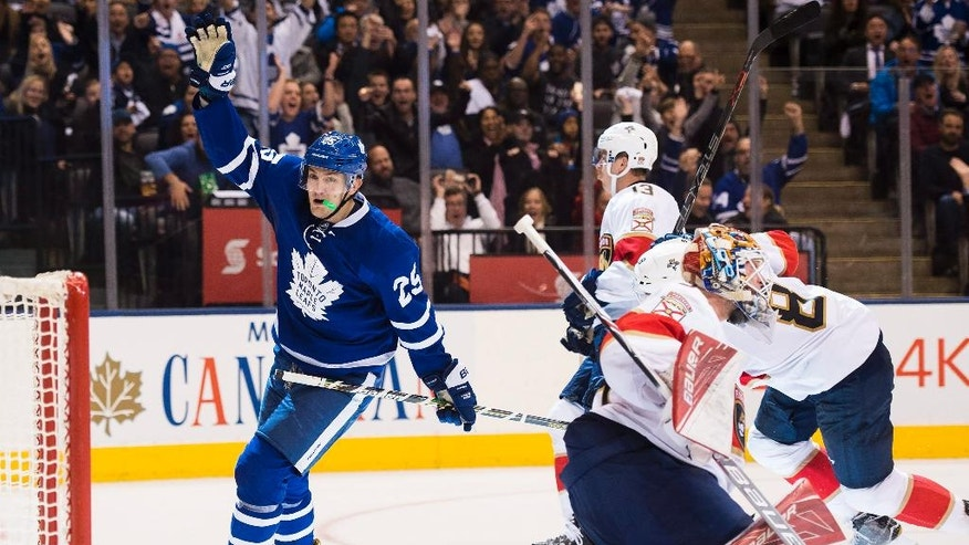 Toronto Maple Leafs left wing James van Riemsdyk (25) reacts after scoring against Florida Panthers goalie James Reimer (34) during second-period NHL hockey game action in Toronto, Thursday, Nov. 17, 2016. (Nathan Denette/The Canadian Press via AP)