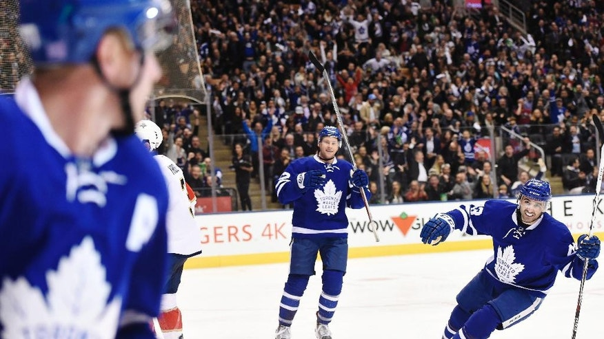 Toronto Maple Leafs center Leo Komarov (47), left, celebrates his goal against the Florida Panthers with teammates Connor Brown (12) and Nazem Kadri (43) during second-period NHL hockey game action in Toronto, Thursday, Nov. 17, 2016. (Nathan Denette/The Canadian Press via AP)