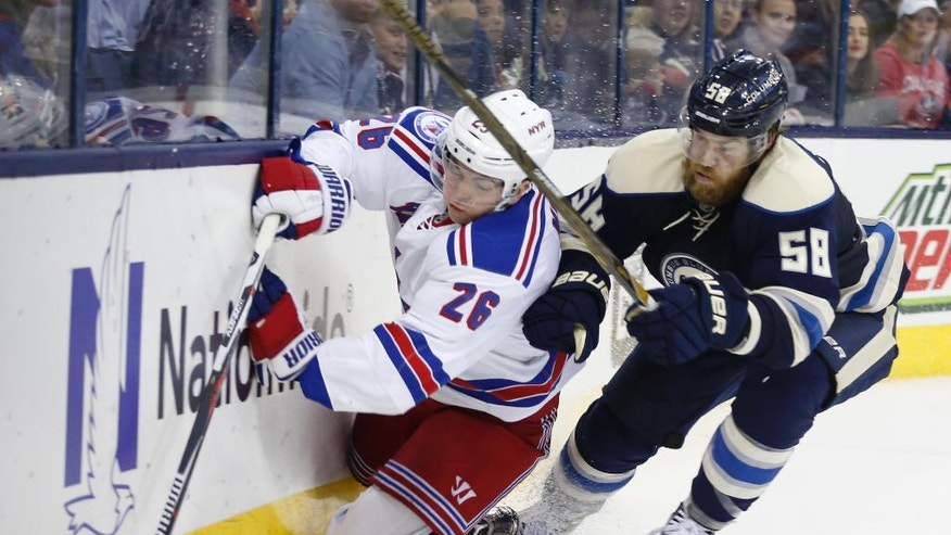 Columbus Blue Jackets' David Savard, right, checks New York Rangers' Jimmy Vesey during the third period of an NHL hockey game Friday, Nov. 18, 2016, in Columbus, Ohio. The Blue Jackets beat the Rangers 4-2. (AP Photo/Jay LaPrete)
