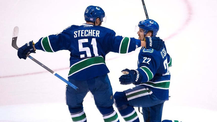 Vancouver Canucks left wing Daniel Sedin (22) celebrates his goal against the Arizona Coyotes with teammate Troy Stecher (51) during the second period of an NHL hockey game Thursday, Nov. 17, 2016, in Vancouver, British Columbia. (Jonathan Hayward/The Canadian Press via AP)