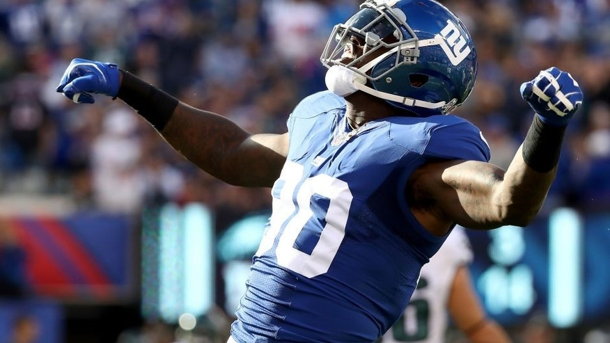 EAST RUTHERFORD, NJ - NOVEMBER 06: Jason Pierre-Paul #90 of the New York Giants reacts after a play against the Philadelphia Eagles during the first half of the game at MetLife Stadium on November 6, 2016 in East Rutherford, New Jersey. (Photo by Al Bello/Getty Images)