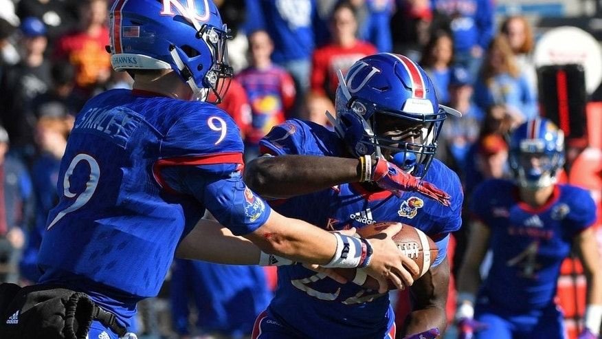 Kansas beats Texas for first time since 1938, 24-21 in OT