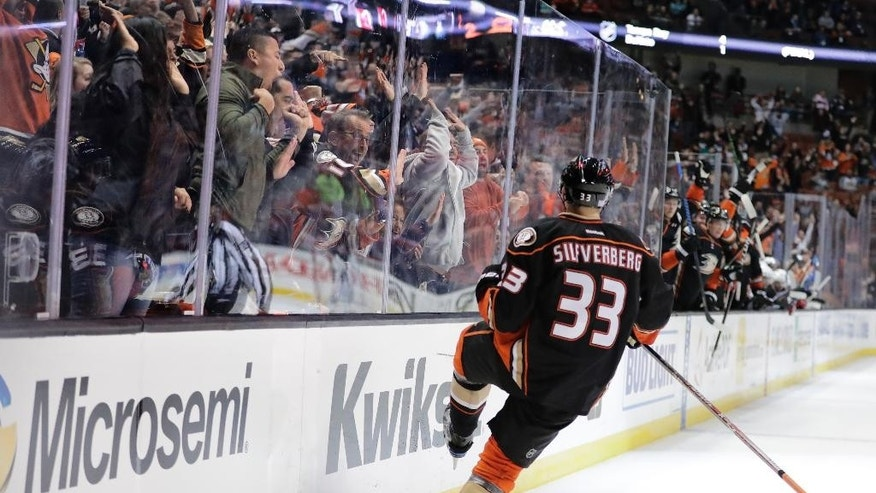 Fans cheer as Anaheim Ducks' Jakob Silfverberg, of Sweden, celebrates his goal during the second period of an NHL hockey game against the New Jersey Devils on Thursday, Nov. 17, 2016, in Anaheim, Calif. (AP Photo/Jae C. Hong)
