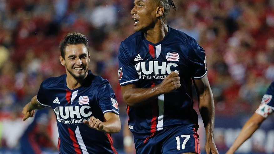 FILE - In this Sept. 13, 2016, file photo, New England Revolution forward Juan Agudelo (17) celebrates his goal against FC Dallas with teammate Diego Fagundez, left, during the first half of the U.S. Open Cup soccer final in Frisco, Texas. Jurgen Klinsmann has grown impatient with the whining American prospects who fail to earn playing time on their clubs. For every player like teen sensation Christian Pulisic, who broke into Borussia Dortmund's lineup at just 17, there are multiple examples of others who flopped in Europe. (AP Photo/Tony Gutierrez, File)