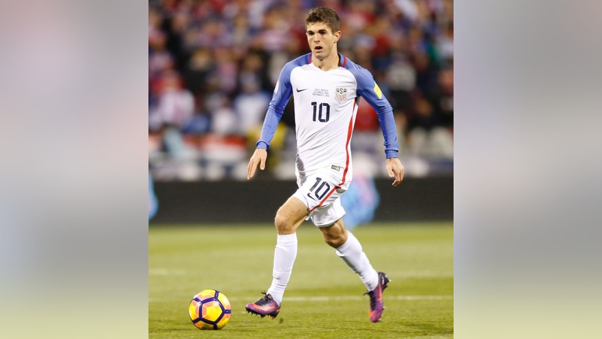 FILE - In this Nov. 11, 2016, file photo, United States' Christian Pulisic plays against Mexico during a World Cup qualifying soccer match  in Columbus, Ohio. Jurgen Klinsmann has grown impatient with the whining American prospects who fail to earn playing time on their clubs. For every player like teen sensation Christian Pulisic, who broke into Borussia Dortmund's lineup at just 17, there are multiple examples of others who flopped in Europe. (AP Photo/Jay LaPrete, File)