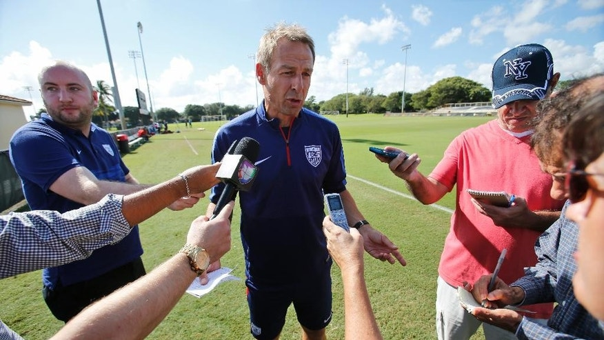FILE - In this Nov. 9, 2015, file photo, U.S. men's national soccer team coach Jurgen Klinsmann speaks to members of the media before the start of practice at Barry University in Miami Shores, Fla. Klinsmann has grown impatient with the whining American prospects who fail to earn playing time on their clubs. For every player like teen sensation Christian Pulisic, who broke into Borussia Dortmund's lineup at just 17, there are multiple examples of others who flopped in Europe. (AP Photo/Wilfredo Lee, File)