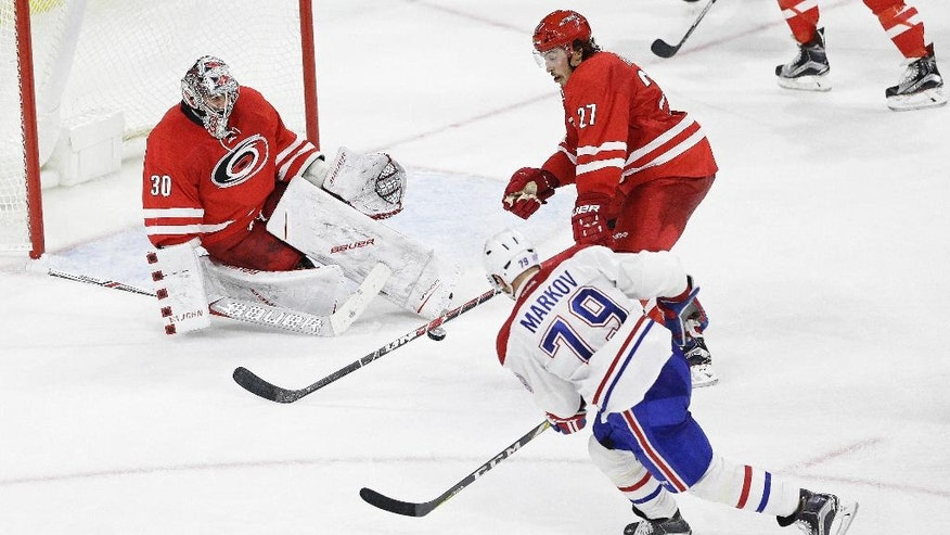 Carolina Hurricanes' Justin Faulk (27) and goalie Cam Ward (30) defend the goal against Montreal Canadiens' Andrei Markov (79), of Russia, during the third period of an NHL hockey game in Raleigh, N.C., Friday, Nov. 18, 2016. Carolina won 3-2. (AP Photo/Gerry Broome)