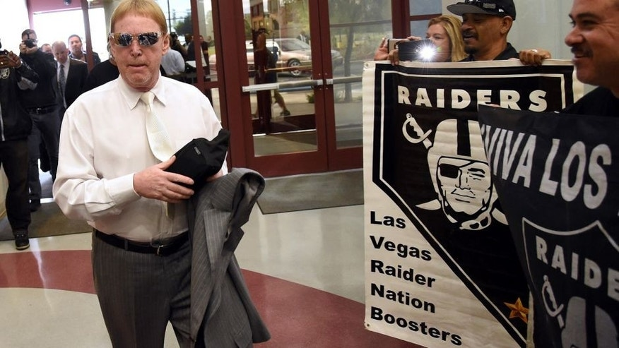 LAS VEGAS, NV - APRIL 28: Oakland Raiders owner Mark Davis walks past fans holding Raiders signs as he arrives at a Southern Nevada Tourism Infrastructure Committee meeting at UNLV on April 28, 2016 in Las Vegas, Nevada. Davis told the committee he is willing to spend USD 500 million as part of a deal to move the team to Las Vegas if a proposed USD 1.3 billion, 65,000-seat domed stadium is built by casino magnate Sheldon Adelson's Las Vegas Sands Corp. and real estate agency Majestic Realty, possibly on a vacant 42-acre lot a few blocks east of the Las Vegas Strip recently purchased by UNLV. (Photo by Ethan Miller/Getty Images)