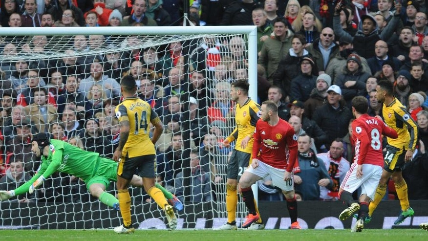 Manchester United's Juan Mata, 2nd right, scores against Arsenal during the English Premier League soccer match between Manchester United and Arsenal at Old Trafford in Manchester, England, Saturday, Nov. 19, 2016. (AP Photo/Rui Vieira)