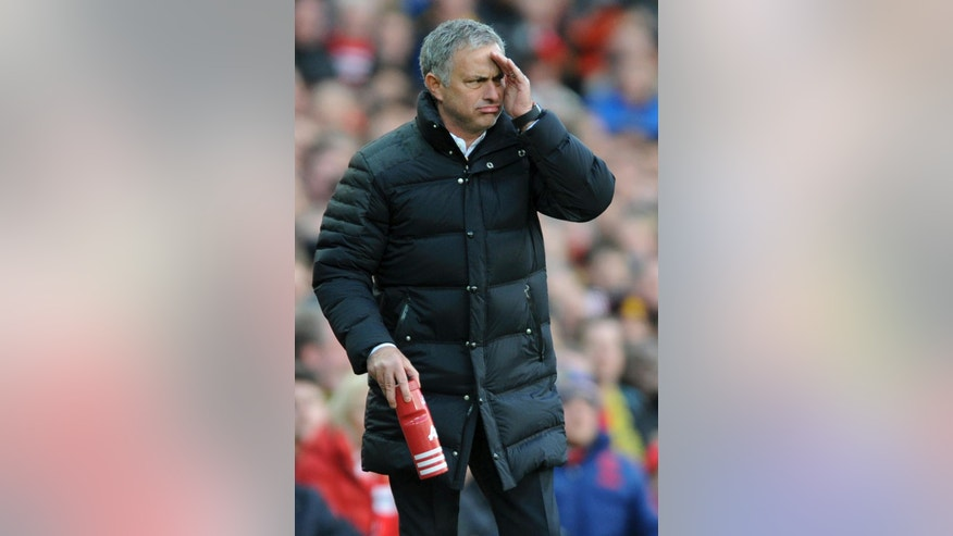 Manchester United manager Jose Mourinho watches the English Premier League soccer match between Manchester United and Arsenal at Old Trafford in Manchester, England, Saturday, Nov. 19, 2016. (AP Photo/Rui Vieira)