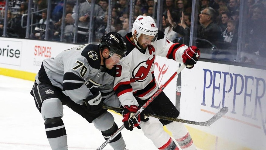 Los Angeles Kings left winger Tanner Pearson (70) and New Jersey Devils center Travis Zajac (19) battle in the second period of an NHL hockey game in Los Angeles Saturday, Nov. 19, 2016. (AP Photo/Reed Saxon)