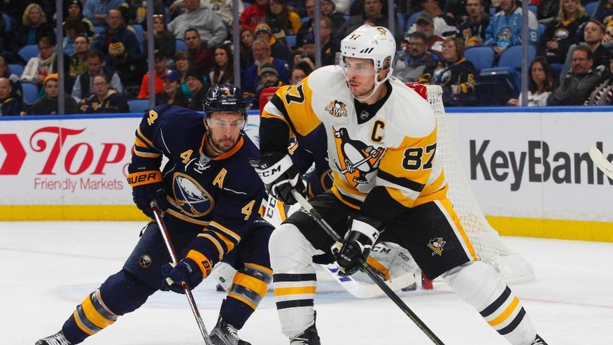 Pittsburgh Penguins forward center Sidney Crosby (87) looks to make a pass as Buffalo Sabres defenseman Josh Gorges (4) puts on the pressure during the second period of an NHL hockey game Saturday, Nov. 19, 2016, in Buffalo, N.Y. (AP Photo/Jeffrey T. Barnes)