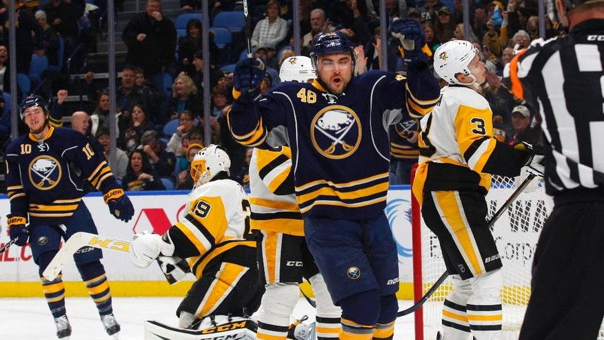 Buffalo Sabres forward William Carrier (48) celebrates his first NHL goal during the first period of a hockey game against the Pittsburgh Penguins, Saturday, Nov. 19, 2016, in Buffalo, N.Y. (AP Photo/Jeffrey T. Barnes)
